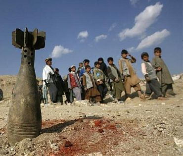 A defused mortar head is planted during a mine and unexploded ordnances awareness class for school boys in Qarabagh district, north of Kabul