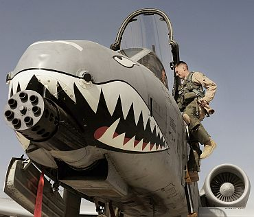 US Air Force Maj Loren Coulter exits an A-10C Thunderbolt II aircraft at Kandahar Airfield, Afghanistan