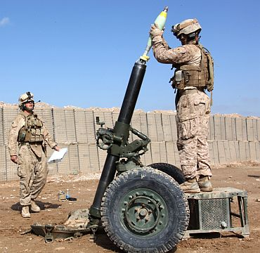 US Marines with the Battalion Landing Team 3/8, 26th Marine Expeditionary Unit, Regimental Combat Team 8, prepare to fire a 120mm mortar at Combat Outpost Ouellette, Helmand province, Afghanistan, March 6, 2011. This was the first time the new Advanced Field Artillery Tactical Data System's Ballistic Computer 11 software was used in the field