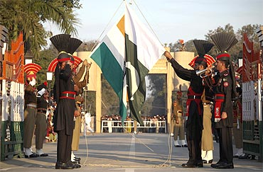 Pakistan Rangers and Border Security Force take part in the daily flag lowering ceremony at the joint border post of Wagah