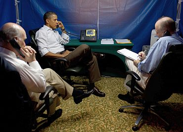 President Barack Obama is briefed on the situation in Libya during a secure conference call with National Security Advisor Tom Donilon, right, Chief of Staff Bill Daley, left, Secretary of State Hillary Clinton, Secretary of Defense Bob Gates, AFRICOM Commander General Carter Ham, and Deputy National Security Advisor Denis McDonough