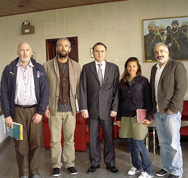 The four New York Times journalists, who had been captured by Libyan forces while covering the conflict there, pose with Turkey's Ambassador to Libya Levent Sahinkaya (C) at the Turkish embassy in Tripoli in this undated handout released March 21, 2011. Libya released the four on Monday, nearly a week after they had been captured, although three journalists for other outlets remained missing. The journalists are reporter and videographer Stephen Farrell (L), photographers Tyler Hicks (2nd L) and Lynsey Addario and two-time Pulitzer Prize winner Anthony Shadid (R)