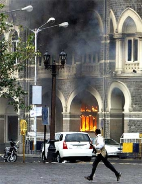The Taj Mahal Hotel burns during the terror strike on Mumbai