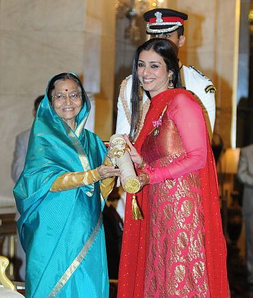 President Pratibha Devisingh Patil presenting the Padma Shri to actress Tabu
