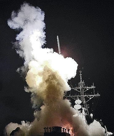 Arleigh Burke-class guided-missile destroyer USS Barry (DDG 52) launches a Tomahawk missile in support of Operation Odyssey Dawn in the Mediterranean Sea