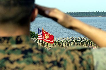 A arine salutes the olours at the start of the 2d Marine Memorial Service for troops who were killed in action during Operation Iraqi Freedom in April, 2006 in Camp Lejeune, North Carolina