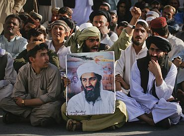 Supporters of Osama bin Laden shout anti-American slogans, after the news of his death, during a rally in Quetta, Pakistan