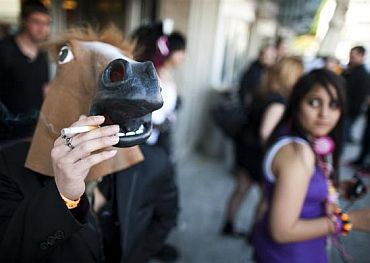 A visitor with a horse mask smokes a cigarette outside of the Polymanga show in Lausanne. Polymanga is the largest manga, anime, video games and pop culture convention in Switzerland gathering over 16,000 visitors over three days at the Palais de Beaulieu in Lausanne
