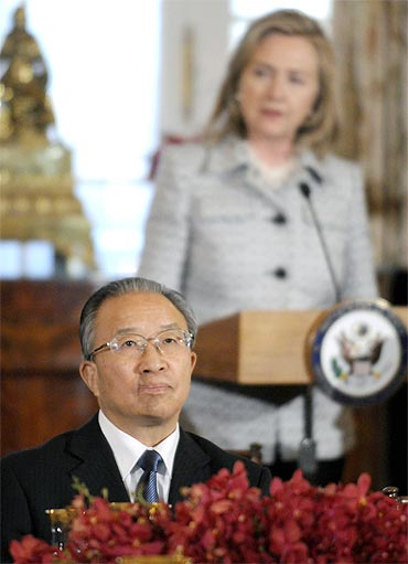 China's Councillor Dai Bingguo listens to US Secretary of State Hillary Clinton in Washington, DC
