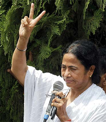 West Bengal chief minister-designate Mamata Banerjee thanks supporters after her party won the assembly elections on May 13, in Kolkata