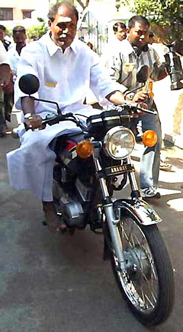 All India NR Congress chief N Rangaswamy on a motorbike in Puducherry