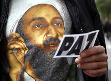 A man wears a T-shirt with the image of Osama bin Laden during a rally