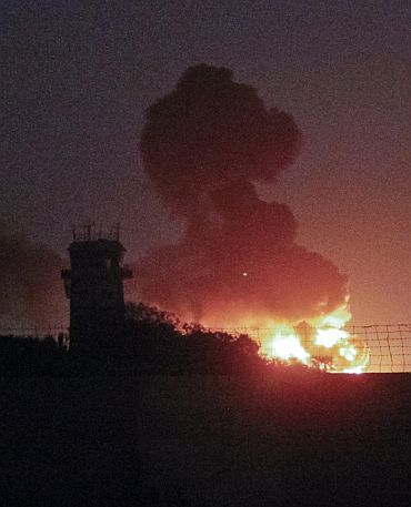 A plume of smoke rises after an explosion at the Mehran naval aviation base which was attacked by militants in Karachi
