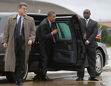 US President Barack Obama steps out of his limousine to get about Air Force One at Andrew Air Force Base near Washington