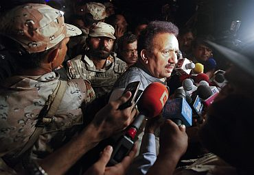Pakistan's Interior Minister Rehman Malik speaks to the media outside Mehran naval aviation base, which was attacked by militants, in Karachi