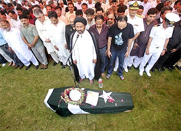 Relatives and officials offer a funeral prayer for Navy officer Lieutenant Yasir Abbas, who was killed when militants attacked the Mehran naval aviation base in Karachi, before his burial in Lahore