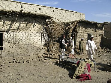 Tribesmen gather at the site of a missile attack on the outskirts of Miranshah in Pakistan in 2008. Suspected US drones fired missiles into this Pakistani village, killing at least seven people, residents and an official said.