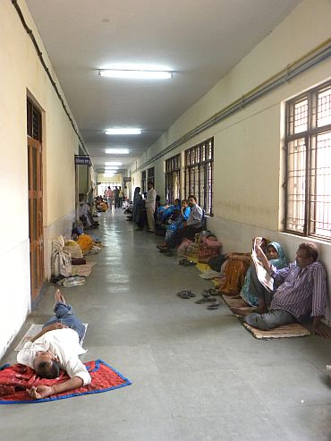 Encephalitis patients' families camp in the medical college's corridors