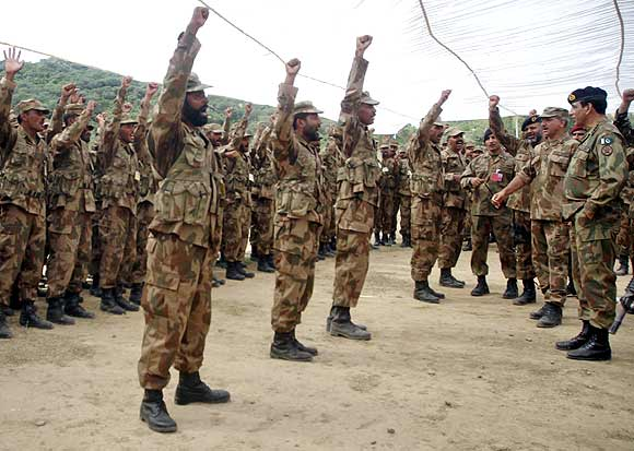 Pakistani soldiers shout 'Allah-hu-Akbar' (God is Great) as Army Chief General Ashfaq Parvez Kayani looks on during  a joint military exercise conducted by Pakistan and Saudi Arabia