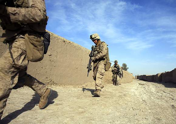 US Marines from Bravo Company of the 1st Battalion, 6th Marines, run during an operation in the town of Marjah, in Nad Ali district of Helmand province in Afghanistan