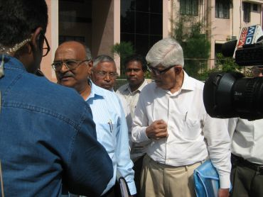 Expert committee members interact with reporters outside the Tirunelveli collectorate