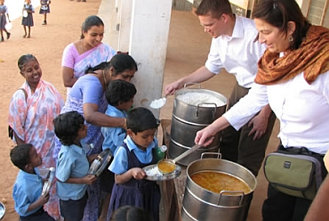 Akshay Patra volunteers serve food to students