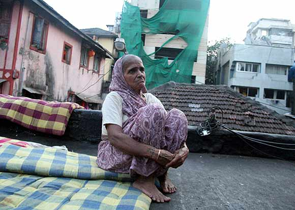 Victim Haresh Gohil's paternal grandmother sits in the backdrop of the Chabad House