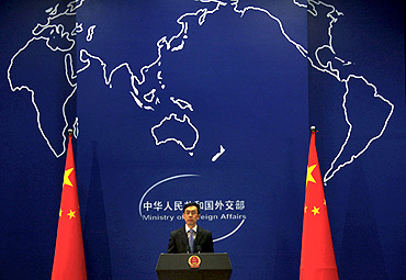 China's Foreign Ministry spokesman Liu Weimin listens to a question during a news conference in Beijing