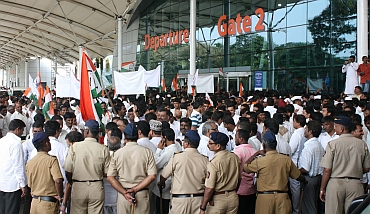 Hundreds of NCP supporters gathered at the domestic terminal in Mumbai to greet Pawar