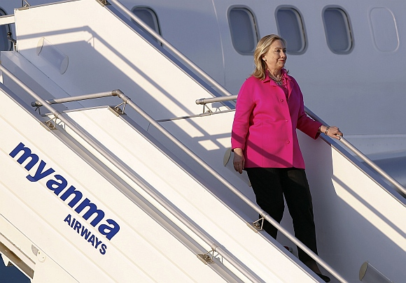 Clinton steps out of her plane after landing in Myanmar's capital Naypyitaw