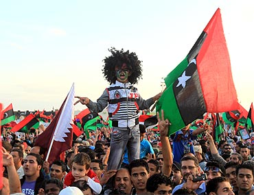 Libyan people gather during celebrations after Muammar Gaddafi's death