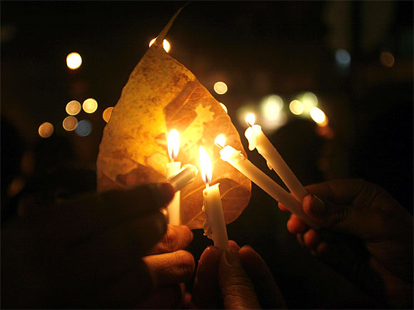 Residents hold candles during a vigil held for 26/11 victims.