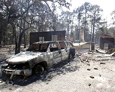 Wildfires swept through an area near Bastrop, Texas destroying vehicles and houses