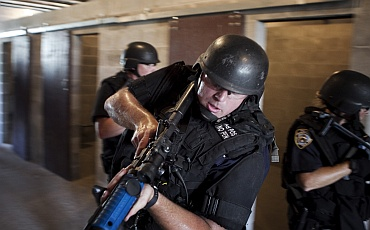NYPD Emergency Service Unit officers practice urban assault tactics during a training session in New York