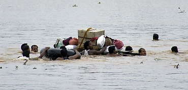 Flood-affected people move their belongings to safer places in Kanasa, Puri