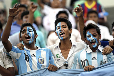 Fans cheer the Argentina soccer team during a practice session in Dhaka