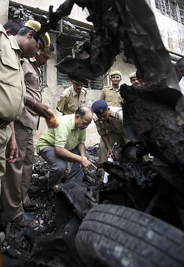 Forensic officer inspects the site of a bomb blast in Ahmedabad in 2008