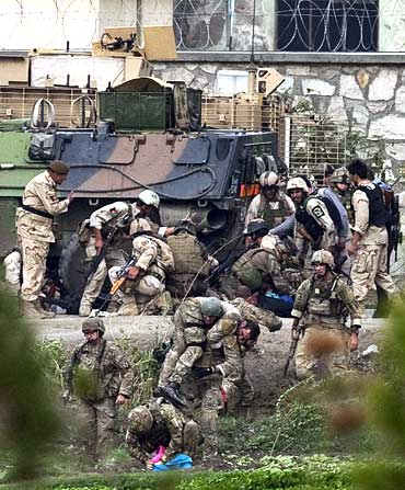 NATO and Afghan troops attend to casualties during a battle with Taliban insurgents