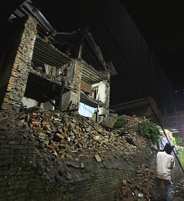 A house, that has been destroyed by the 6.8 magnitude earthquake that struck Sikkim and Nepal, is seen in Bhaktapur