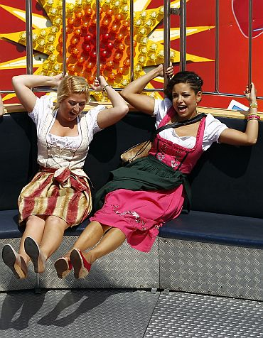 Visitors ride a carousel during the first day of the Munich Oktoberfest