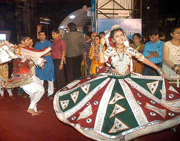 A reveller show off her vibrant outfit at the Sankalp garba dance at Goregaon Sport Club in Mumbai