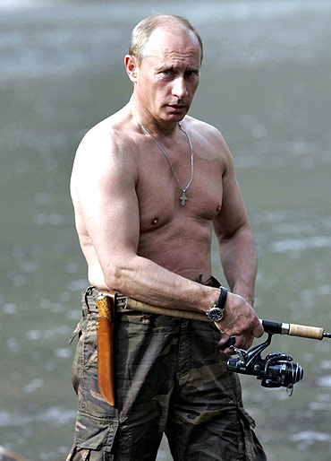 Vladimir Putin fishes in the Khemchik river in southern Siberia's Tuva region, August 15, 2007
