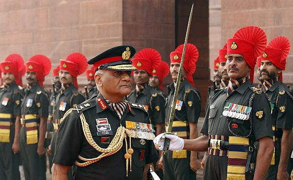 Army Chief General Singh inspects a guard of honour in New Delhi