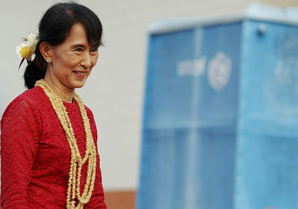 Aung San Suu Kyi smiles as she visits a polling station in Kawhmu township on Sunday