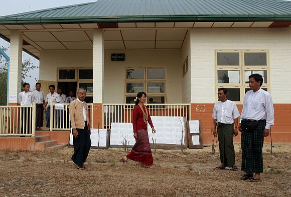 Aung San Suu Kyi visits a polling station in Kawhmu township on Sunday