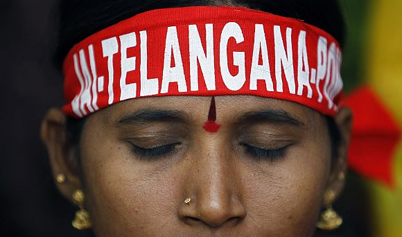 A pro-Telangana supporter listens to a speaker during a protest in New Delhi