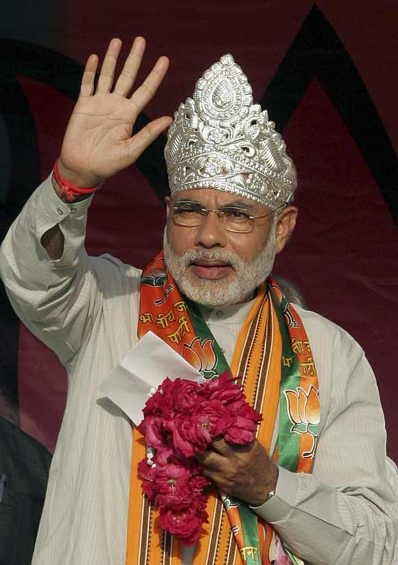 Narendra Modi waves to his party's supporters