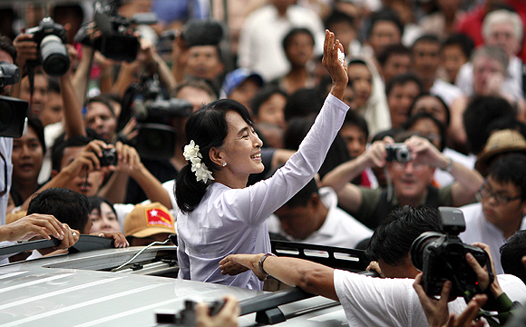 Myanmar's pro-democracy leader Aung San Suu Kyi leaves her party office