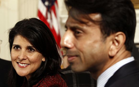 Nikki Haley and Bobby Jindal are seated together at the National Governors Association in the State Dining Room of the White House in Washington, DC