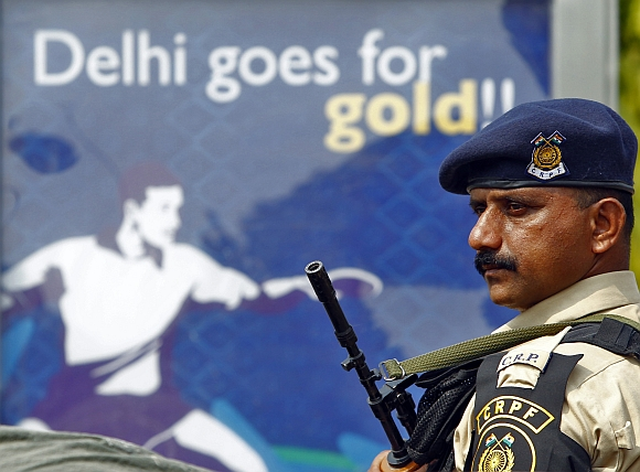A CRPF personnel stands guard outside the Jawaharlal Nehru Stadium in New Delhi